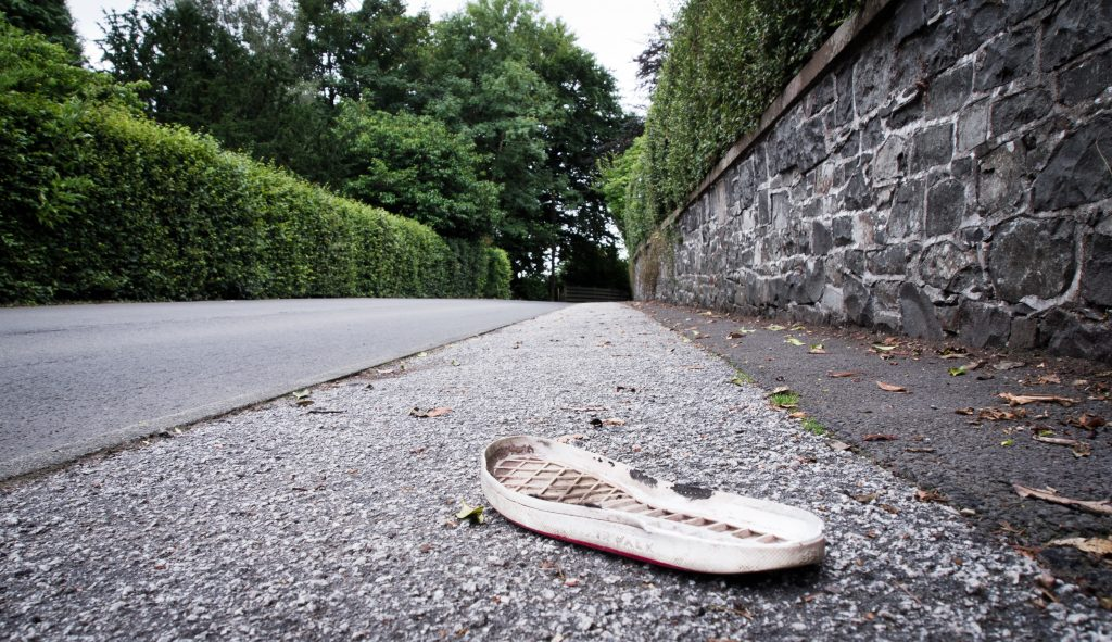 Only the Sole Remains: a shoeless sole on a suburban pavement. By Eryl Gasper-Dick