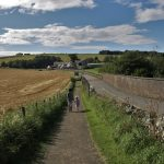 A woman and her granddaughter walking on the path from Coldingham to St Abbs